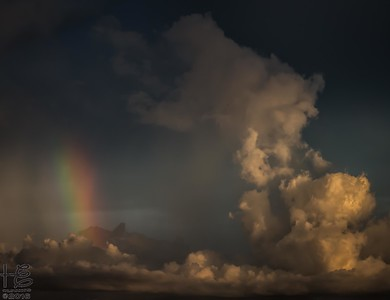 Rainbow within the clouds