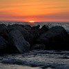 ROCKS, A SUNSET AND LAKE MICHIGAN  HOLAND MICHIGAN