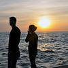 2 PEOPLE, A SUNSET AND LAKE MICHIGAN  HOLAND MICHIGAN