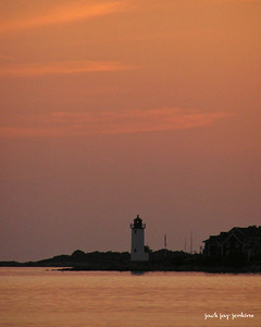 The sky lightens over Annisquam lighthouse.