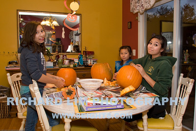 The Lim girls carving pumpkins from the Howell Farmers Market. Left to Right Katie, Madi and Rachel.