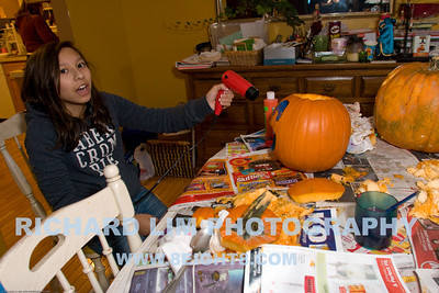 Katie drying the paint on her pumpkin.
