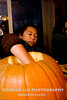 """Madi cleaning out the pumpkin gut and """"harvesting"""" the seeds."""