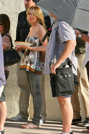 "Linsday Lohan on the set of "" Labor Pains "" look really study, friendly and beautiful."