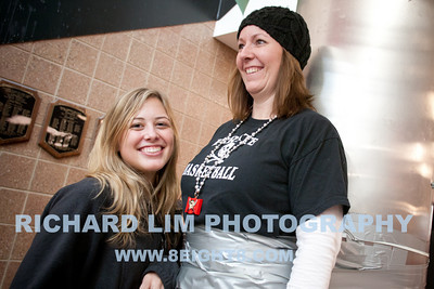 Pinckney High School senior, Kayce Hoppstock adding another layer of duct tape to Math teacher, Lori Maurer.