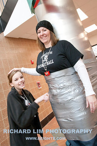 High school Junior, Taylor Mite, adding the finishing touches to duct taped teacher, Lori Maurer.