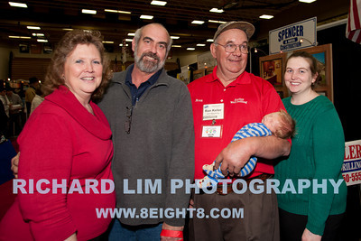 Home & Garden Show visitors Becky Lybrink, Mark Lybrink, Ron Keller of Keller Well Drilling with two and a half weeks old Logan DeGrandchamp and Jennifer DeGrandchamp.
