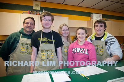 Howell High School Band Boosters food station manned by (L to R) Mark Michaels (Parent), Michael Beard (Sophomore-Clarinet), Katie Bondie (Junior-Saxophone), Katy Michaels (Freshman-Trumpet) and Tyler Homrich (Sophomore-Trumpet).