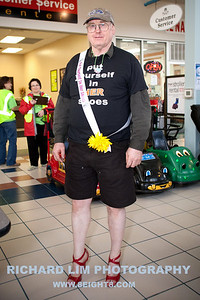 William Lownsberry from Wolverine, MI donning on some heels supporting this year's LACASA Walk a Mile in Her Shoes event. Photo by RICHARD LIM PHOTOGRAPHY