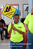 Theo Billups, 9, came all the way from Harper Woods, MI for this year's LACASA Walk a Mile in Her Shoes event, as his father, Paul, looks on. Photo by RICHARD LIM PHOTOGRAPHY