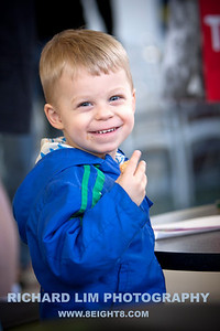 Timothy Lewis, 2, enjoying some goodies. Photo by RICHARD LIM PHOTOGRAPHY