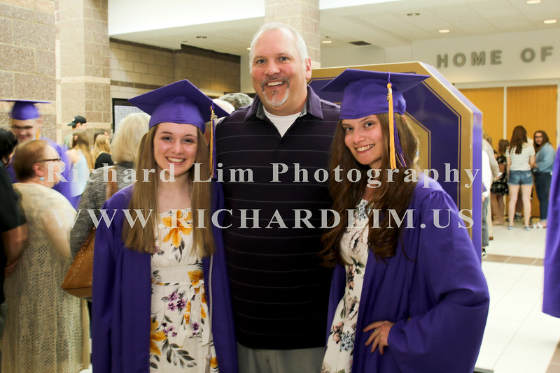 L-R Emma Holley, Craig Curtis and Olivia Murray waiting for the start of the graduation ceremony at Fowlerville High School. Photo by Richard Lim Photography.