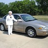 Mom in their front yard driveway with new car - 2007