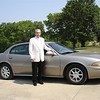 Dad in their front yard driveway with new car - 2007