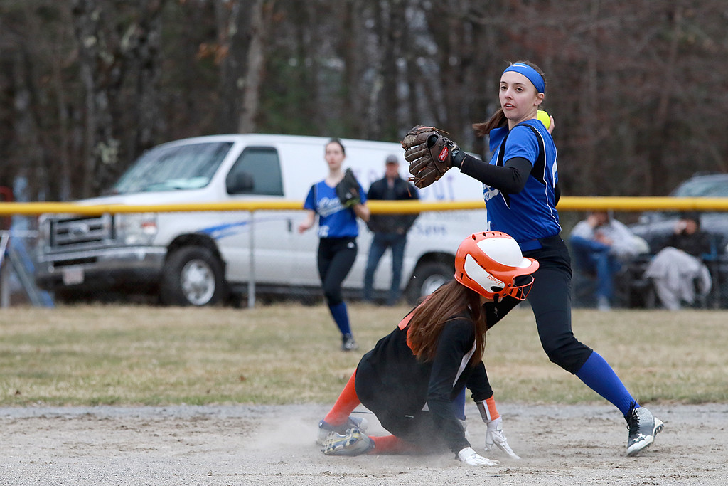 . Lunenburg Middle High School softball played Gardner High School on Friday afternoon, April 12, 2019. LMHS\'s Emma Marinchev gets ready to throw to first after getting out GHS\'s Cora Merchant as she tried to slide into second base. Merchant drove in three runs and Gardner won, 12-4. SENTINEL & ENTERPRISE/JOHN LOVE