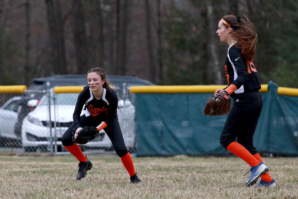 . Lunenburg Middle High School softball played Gardner High School on Friday afternoon, April 12, 2019. GHS\'s Kayla Keenan pick up a ground ball to center field during action in the game. SENTINEL & ENTERPRISE/JOHN LOVE