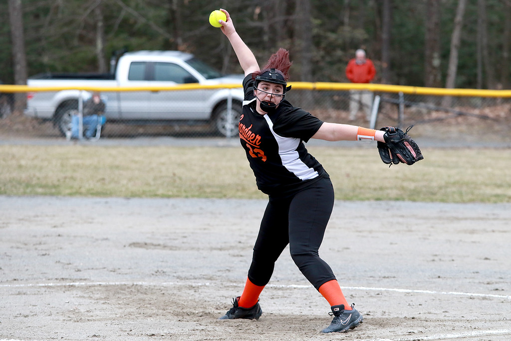 . Lunenburg Middle High School softball played Gardner High School on Friday afternoon, April 12, 2019. GHS\'s Pitcher Maddy Lashua winds up to deliver a pitch during action in the game. SENTINEL & ENTERPRISE/JOHN LOVE