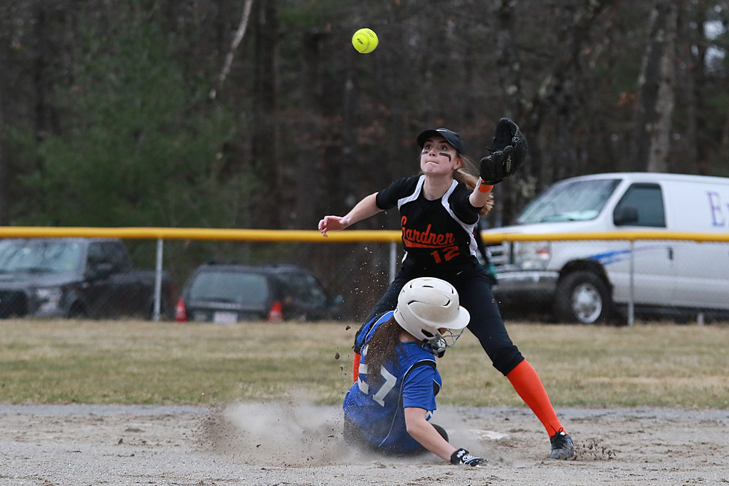. Lunenburg Middle High School softball played Gardner High School on Friday afternoon, April 12, 2019. LMHS\'s Leah Sowerbutts slides safe into second as GHS\'s Becca Lashua waits for the throw. SENTINEL & ENTERPRISE/JOHN LOVE