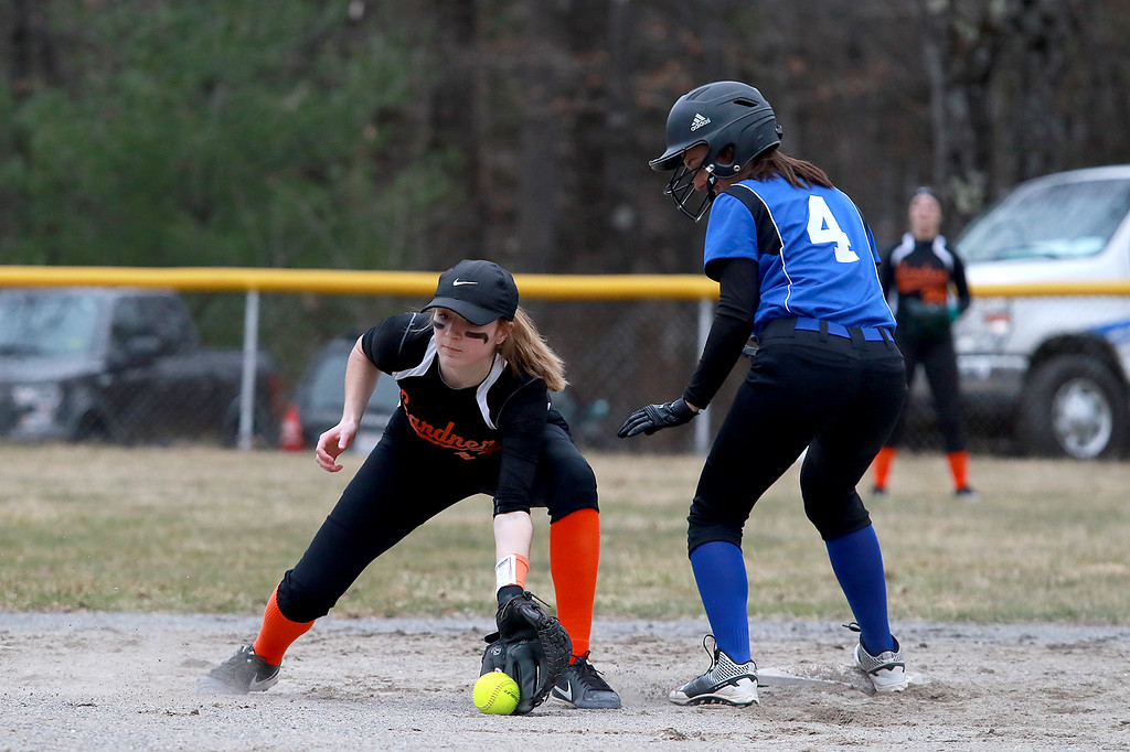 . Lunenburg Middle High School softball played Gardner High School on Friday afternoon, April 12, 2019. GHS\'s Becca Lashua reaches forhe throw to second that was just a bit late and LMHS\'s Emma Marinchev makes it easily. SENTINEL & ENTERPRISE/JOHN LOVE