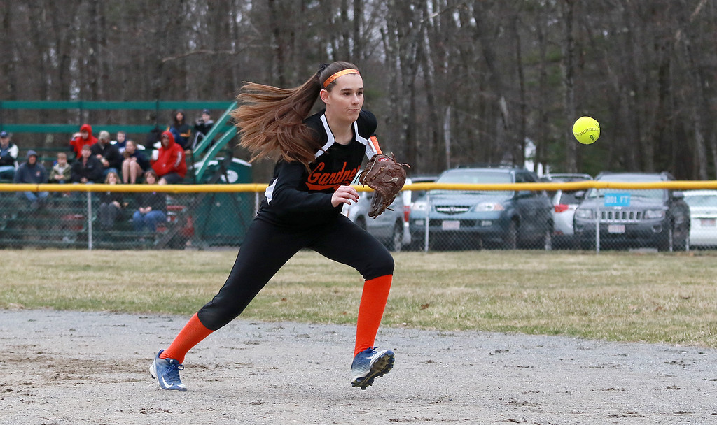 . Lunenburg Middle High School softball played Gardner High School on Friday afternoon, April 12, 2019. GHS\'s Cora Merchant goes after a ground ball during action in the game. SENTINEL & ENTERPRISE/JOHN LOVE