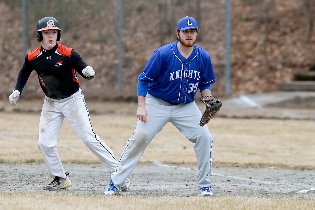 . Lunenburg Middle High School baseball played Gardner High School on Friday afternoon, April 12, 2019. GHS\'s Anthony Richard leads off first as LMHS\'s first baseman Josh Proctor watches the batter during action in the game. SENTINEL & ENTERPRISE/JOHN LOVE