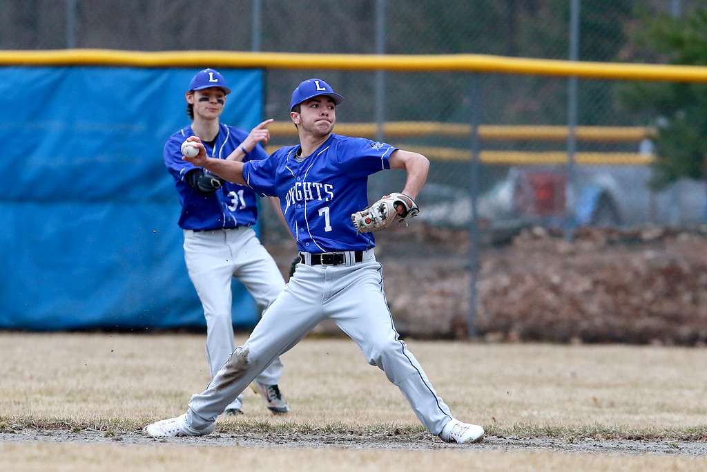 . Lunenburg Middle High School baseball played Gardner High School on Friday afternoon, April 12, 2019. LMHS\'s Braeden Gendron winds up to throw a ground ball to first during action in the game. SENTINEL & ENTERPRISE/JOHN LOVE