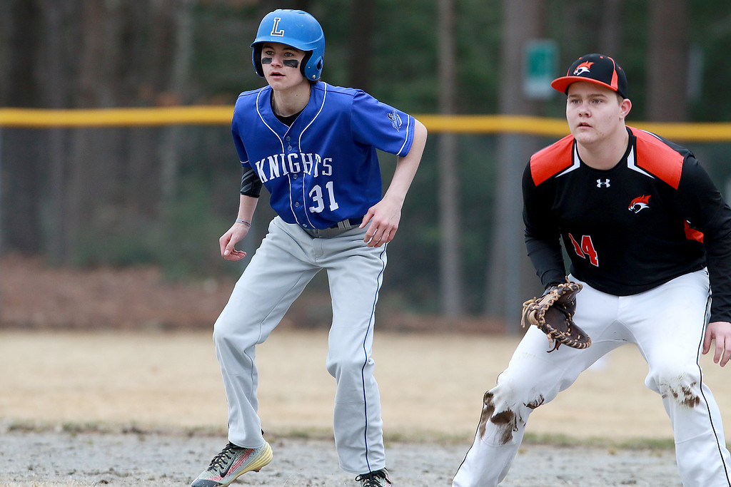 . Lunenburg Middle High School baseball played Gardner High School on Friday afternoon, April 12, 2019. LMHS\'s Colin Garrity leads off first as GHS\'s first baseman Killian Kavanaugh watches the batter during action in the game. SENTINEL & ENTERPRISE/JOHN LOVE