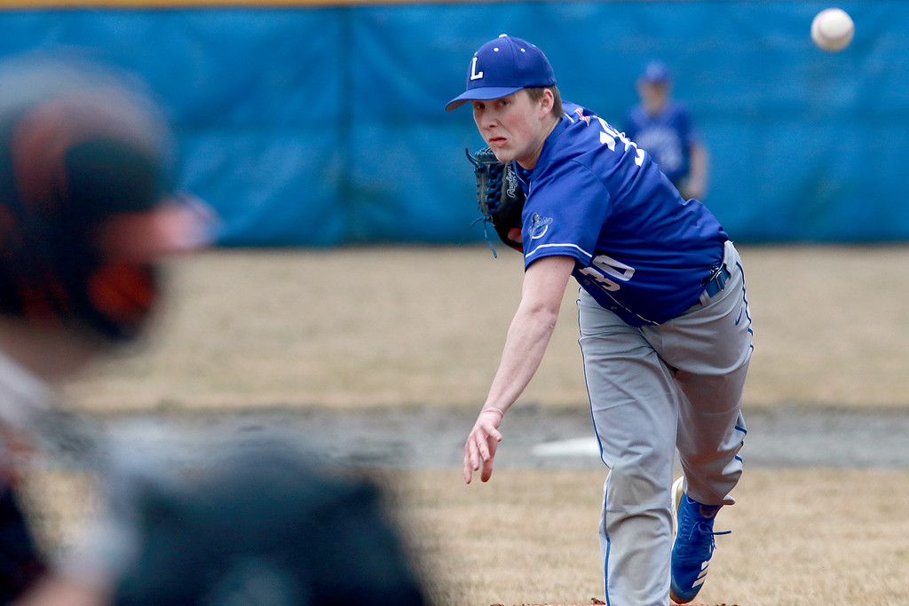. Lunenburg Middle High School baseball played Gardner High School on Friday afternoon, April 12, 2019. LMHS\'s pitcher Alan Hyatt winds up to deliver a pitch during the game. SENTINEL & ENTERPRISE/JOHN LOVE