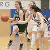 Oakmont Regional High School girls basketball played Lunenburg Middle High School on Friday night, Feb. 14, 2020 in Lunenburg. LMHS's #23 Bella Petricca reaches to knock the ball away from ORHS's #21 Jessica Lee. SENTINEL & ENTERPRISE/JOHN LOVE