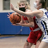 Lunenburg Middle High School girls basketball played Tyngsboro High School on Thursday night at home. Driving to the basket is THS's #12 Carly DiMento. SENTINEL & ENTERPRISE/JOHN LOVE