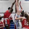 Lunenburg Middle High School girls basketball played Tyngsboro High School on Thursday night at home. Going up for a rebound is THS's #25 Halle Bangura and LMHS's #24 Katie Motyka. SENTINEL & ENTERPRISE/JOHN LOVE
