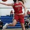 Lunenburg Middle High School girls basketball played Tyngsboro High School on Thursday night at home. Trying to stop the ball from going out of bounds is THS's #11 Jayden Kelly. SENTINEL & ENTERPRISE/JOHN LOVE