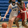 Lunenburg Middle High School girls basketball played Tyngsboro High School on Thursday night at home. THS's #25 Halle Bangura tries to stop LMHS's #23 Bella Petricca as she drives to the basket. SENTINEL & ENTERPRISE/JOHN LOVE