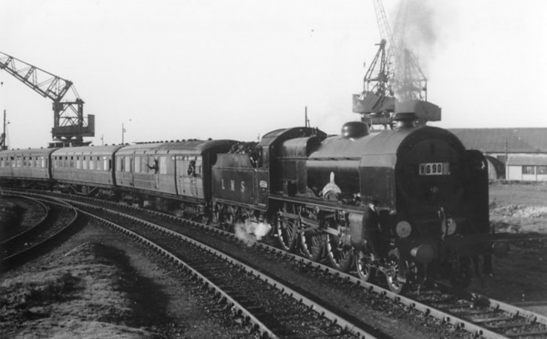 45516 The Bedfordshire and Hertfordshire Regiment Southampton Docks on a special Troop train 17th February 1950. The loco travelled to Southampton Docks to haul a troop train of men of the regiment .
