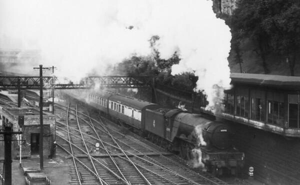 60098 Spion Kop on a Kings Cross to Glasgow service leaving Edinburgh Waverley 3rd July 1954