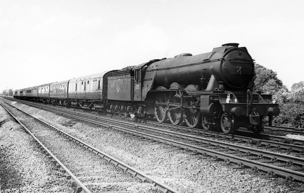 60112 St  Simon with an up relief at Werrington-Marholme crossing 16th June 1962