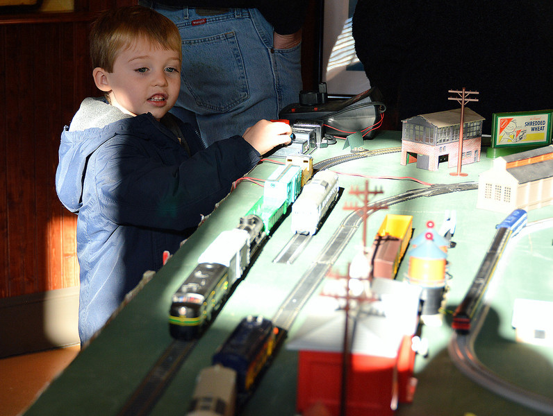 News-Herald photo — DEBBY HIGH<br /> Austin David, 4, plays with the model train set at the Perkasie Historical Society Museum.