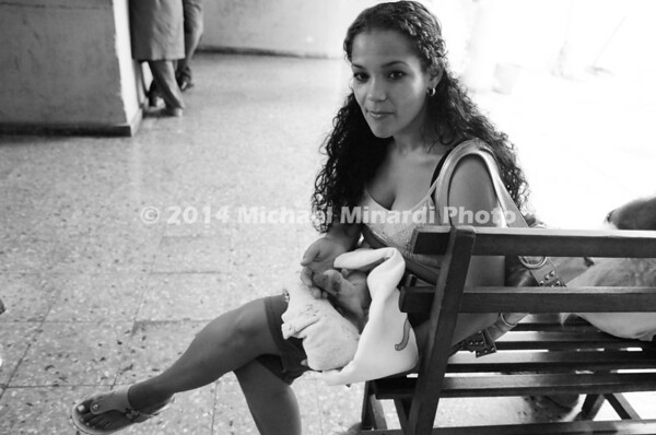 Cuban Woman with new born puppy