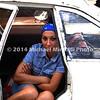 Cuban girl in white car EPV1895