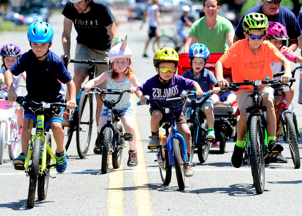 . From left to right, Braxton Waller, 6, Dexter Gibson, 4, and Burton Henry take off on the start of the kids race in the 31st Annual Longmont Criterium  on Sunday. For more photos go to timescall.com Paul Aiken Staff Photographer July 9, 2017