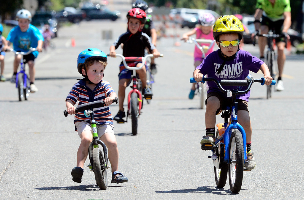 . Maddock Myers, 4, puts his strider bike to the test as he tries to keep up with Dexter Gibson during the kids race in the 31st Annual Longmont Criterium  on Sunday. For more photos go to timescall.com Paul Aiken Staff Photographer July 9, 2017
