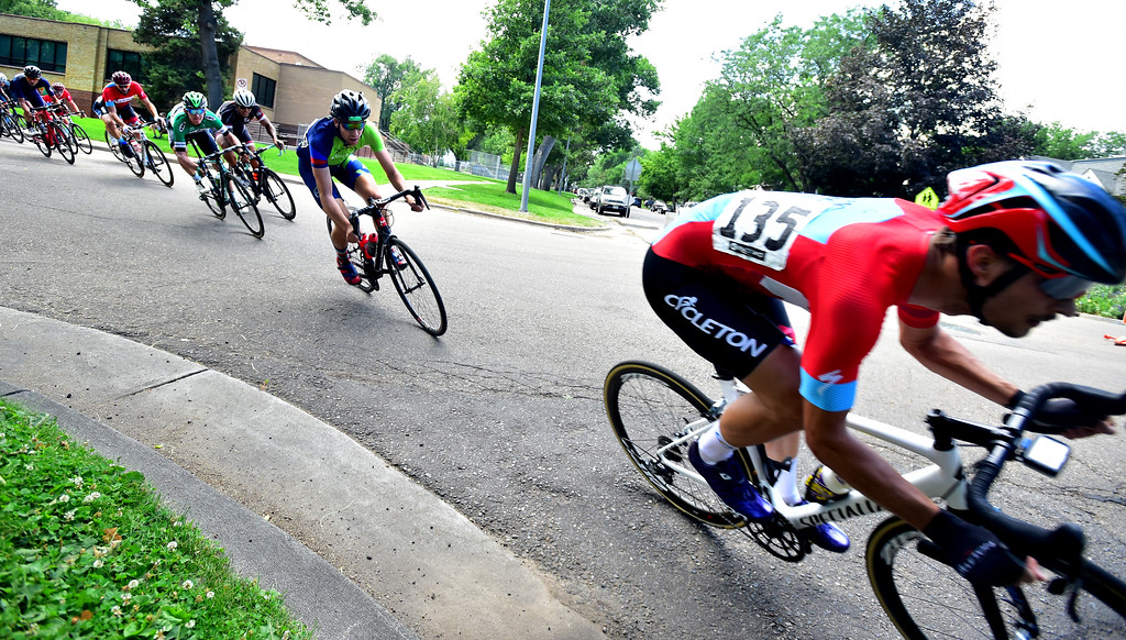 . Matthew Kotarbinski is chase by riders as they round a turn in the Senior Men\'s Pro Race Level 1-2-3  in the 31st Annual Longmont Criterium  on Sunday. For more photos go to timescall.com Paul Aiken Staff Photographer July 9, 2017