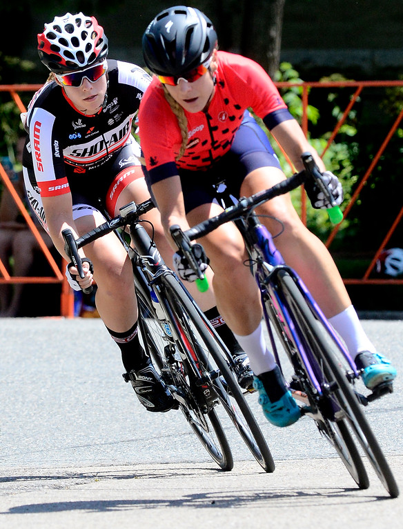 . Jennifer Valente, lefts tracks down Anne Donley during the Senior Women\'s Pro Race Level 1-2-3 in the 31st Annual Longmont Criterium  on Sunday. Valente won the race and Donley finished fourth. For more photos go to timescall.com Paul Aiken Staff Photographer July 9, 2017