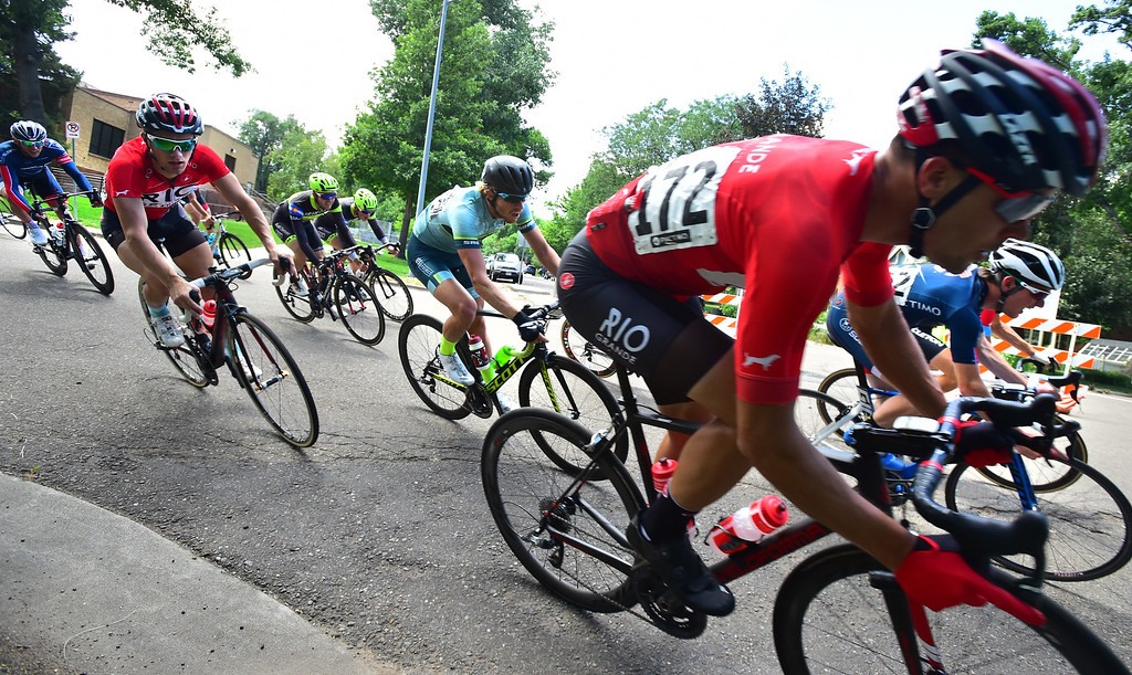 . Nate Taggatz is chase by riders as they round a turn in the Senior Men\'s Pro Race Level 1-2-3  in the 31st Annual Longmont Criterium  on Sunday. For more photos go to timescall.com Paul Aiken Staff Photographer July 9, 2017