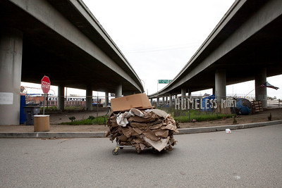 FRESNO, CA--- This cart of carboard will be sold by Ray Polk to help feed and clothe his fellow homeless. Polk is a one-man homeless shelter and provides food, clothing, counseling, shelter, and recently has erected a memorial under the Highway 41 overpass in an encampment in South Fresno to honor the homeless  who have passed away. Polk has made 77 markers  and has plans to make for 23 more.  Polk can tell  a story about how each of those memorialized and how the met their demise.