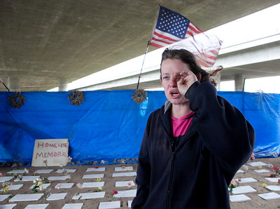 FRESNO, CA--- Christina Calkins, 24, talks about living on the streets for one year and a half in front of  a homeless  memorial erected by Ray Polk under the Highway 41 overpass.  Polk started the memorials in South Fresno to honor the homeless  who have passed away. There are 77 markers with plans for 23 more.