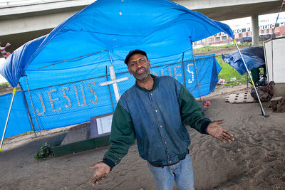 FRESNO, CA--- FRESNO, CA--- Ray Polk talks about his homeless ministry in front of his homeless compound.  Polk is a one-man homeless shelter and provides food, clothing, counseling, shelter, and recently has erected a memorial under the Highway 41 overpass in an encampment in South Fresno to honor the homeless  who have passed away. Polk has made 77 markers  and has plans to make for 23 more.  Polk can tell  a story about how each of those memorialized and how the met their demise.