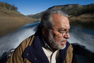 Friant,CA--- Mario Santoyo, Friant Water Authority, talks while giving a tour of Millerton Lake which is fed by the San Joaquin River on Monday, Dec. 14, 2009. The Friant Water Authority is lobbying for a new reservoir at Temperance Flat which is just East of Millerton Lake. The Friant Water Authority would be the chief beneficiary of the new project.  The price tag for the project is some $3.36 billion and could be built in 15 years.  It would provide 1,200,000 acre-feet of storage and an additional 160,000 acre-feet of usable annual water. Critics of the dam and reservoir say that the price tag is too high. The Friant Water District say the reservoir would make more water available in the Central Valley. The new reservoir is roughly 1 1/2 times the size of Millerton Lake. Photo by Tomas Ovalle