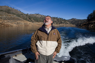 Friant,CA--- Mario Santoyo, Friant Water Authority, laughs while giving a tour of Millerton Lake on Monday, Dec. 14, 2009. The San Joaquin River feeds into Millerton Lake. The Friant Water Authority is lobbying for a new reservoir at Temperance Flat which is just East of Millerton Lake. The Friant Water Authority would be the chief beneficiary of the new project.  The price tag for the project is some $3.36 billion and could be built in 15 years.  It would provide 1,200,000 acre-feet of storage and an additional 160,000 acre-feet of usable annual water. Critics of the dam and reservoir say that the price tag is too high. Photo by Tomas Ovalle