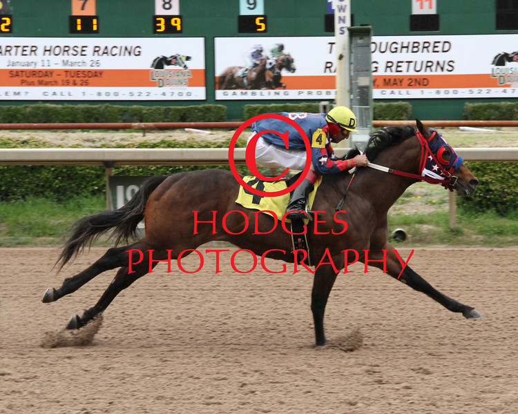 3/15/2014  Heza Fast Rogue with Donald Watson aboard cruises to an easy victory in the 8th running of the Mardi Gras Derby at Louisiana Downs. Hodges Photography / Lynn Roberts